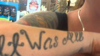 tattoos on a womans arms and feet in pauls market in nampa idaho