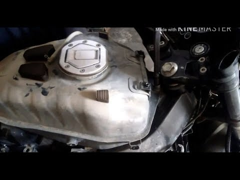 Remove fuel tank from pulsar 200 ns and clean Air Filter