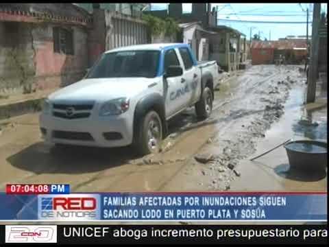 Familias afectadas por inundaciones siguen sacando lodo en Puerto Plata y Sosúa