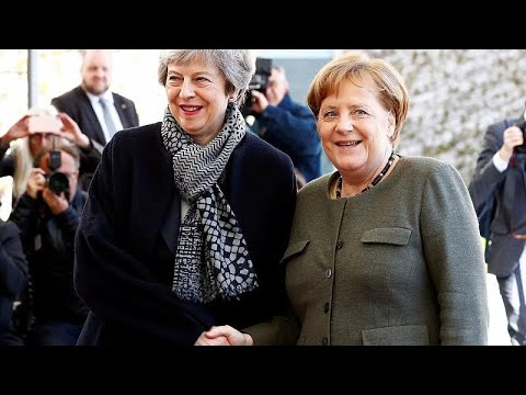 May and Merkel meet as UK parliament passes Brexit delay law