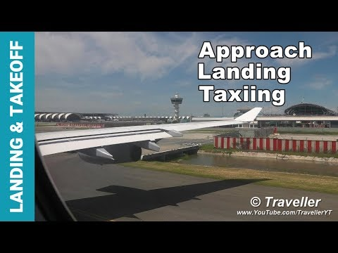 lufthansa-airbus-a340-wing-view-landing-at-bangkok-suvarnabhumi-airport---economy-class