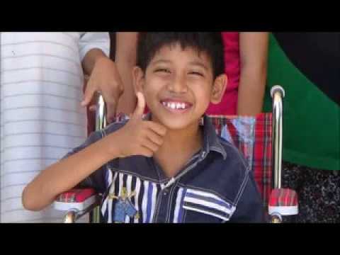 Wheelchairs for the children of Sekolah Luar Biasa. Bali (Phone version)
