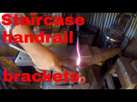 Forging staircase handrail brackets.