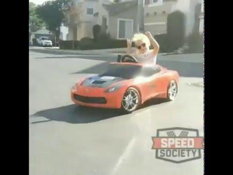 little girl drifting toy car