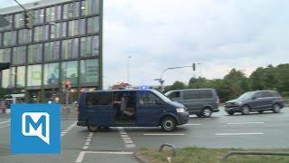 Amoklauf in München: Polizisten fahren in Richtung der Innenstadt