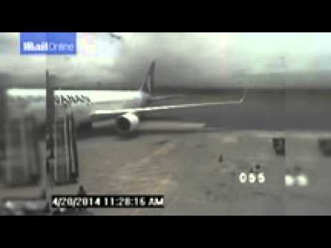 Moment Hawaii flight stowaway staggered out of plane