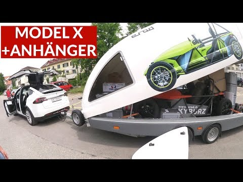Tesla Model X Zieht Anhänger Mit Anderem Elektrofahrzeug Drinnen