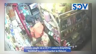 Women caught on a CCTV camera shoplifting foodstuff in a supermarket