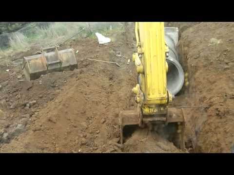 Excavator digging and laying 1500mm storm water pipes.