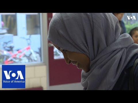 Somali-American candidate for Congress Ilhan Omar votes in primary