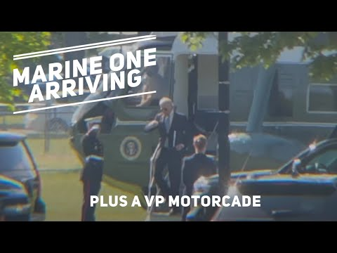 Marine One lands at the White House Ellipse just as the Vice President's motorcade arrives.