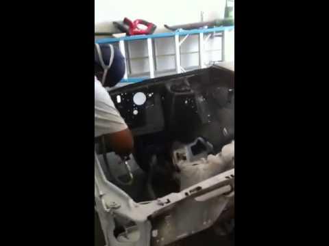 Henry spraying my engine bay.