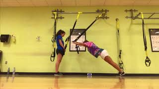 TWO TEENAGE GIRLS TRY DIFFICULT TRX MOVES FOR THE FIRST TIME