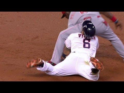 Villar slides into Phillips' backside
