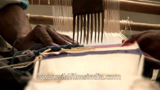 Weaving colorful cloth patterns on a Hand-loom in Uttar Pradesh, India