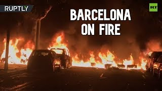 Fires burn on Barcelona streets as police clash with demonstrators