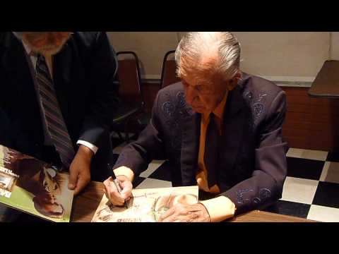 Country Hall of Fame Singer Ray Price signing several autographs - TopSignatures.com