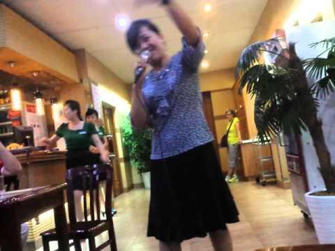 North Korean Guide Sings Karaoke