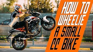 How to wheelie a small cc bike | RokON VLOG #25