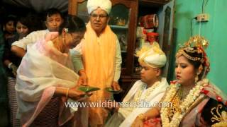 Guests greet newly wedded couple with betel nuts and leaves - Manipur