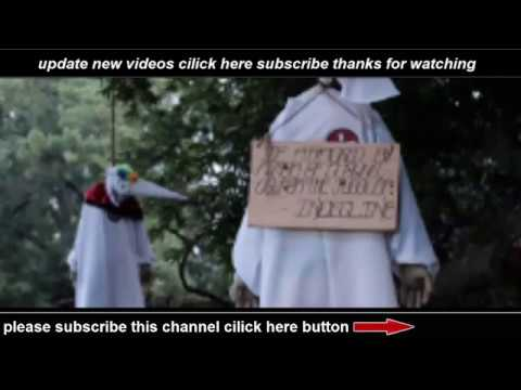 Clowns dressed in KKK robes hung from tree by activist group