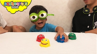 Toddler and Daddy playing FOOL THE FROG game tabletop toys for kids family fun