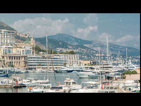 Monte Carlo city aerial panorama timelapse. View of luxury yachts and buildings in harbor of Monaco
