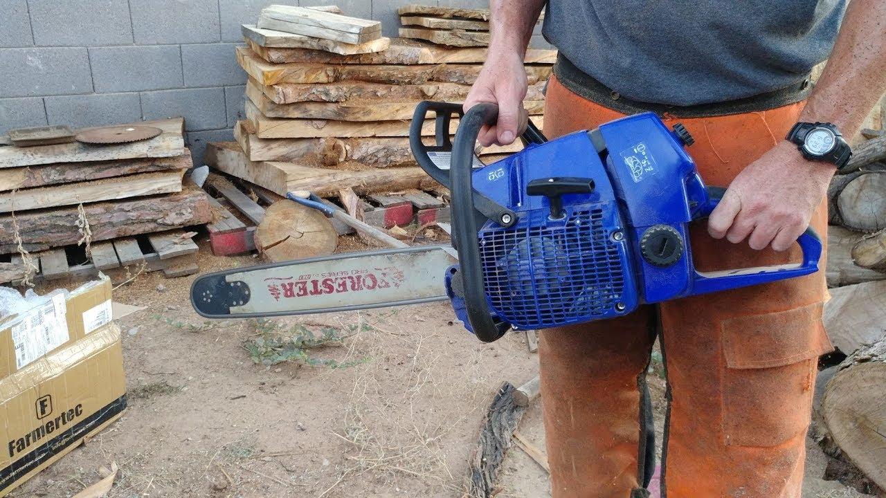 Holzfforma Farmertec G660 chainsaw cutting wood