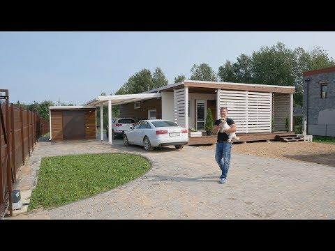 Одноэтажный дом с террасой и навесом для двух автомобилей «Зефир в шоколаде».