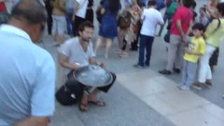 Beautiful steel drums at Notre Dame, Paris, plus cathedral bells. You