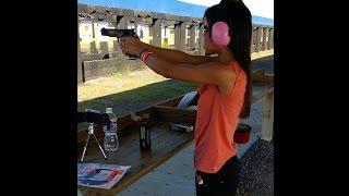 girl shooting a 45 acp 1911 les baer like a pro