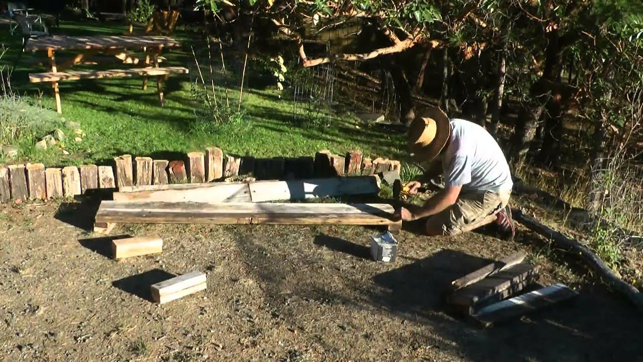 Making A Raised Garden Bed Using Old Wood Youtube