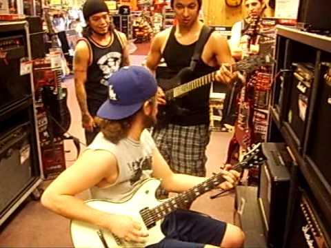 Carlos and Roland from Antagonist Jam at Guitar Center Sacramento
