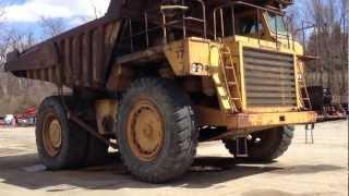 GIANT CAT 777 CATERPILLAR ROCK HAULING TRUCKS IN UNIONTOWN, PENNSYLVANIA.
