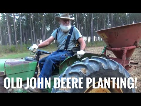 John Deere and New Holland Tractors Planting fields