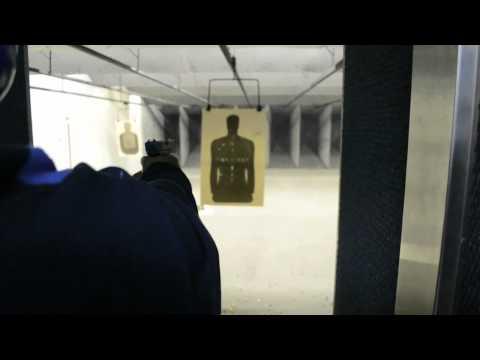BLIND MAN AT THE GUN RANGE SHOOTING A PISTOL