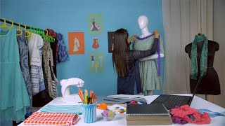 Successful entrepreneur happily working on her upcoming designer dress - Fashion studio