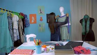 Successful entrepreneur happily working on her upcoming designer dress - Fashion studio