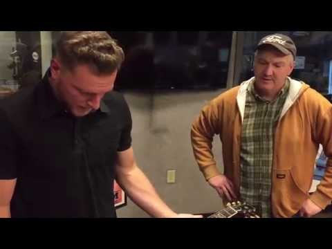 Pat McAfee fumbles the George Harrison guitar owned by Colts owner Jim Irsay