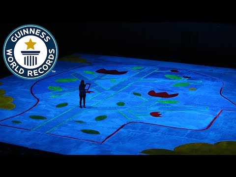 Largest UV blacklight painting- Guinness World Records Day