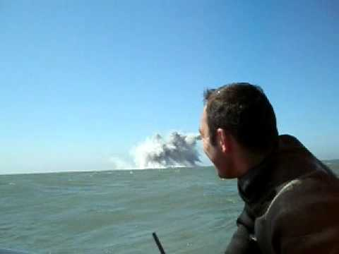 Navy clearance divers blow up huge sea mine 2.