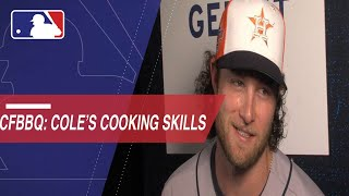Cole gives some cooking tips to Cespedes Family BBQ