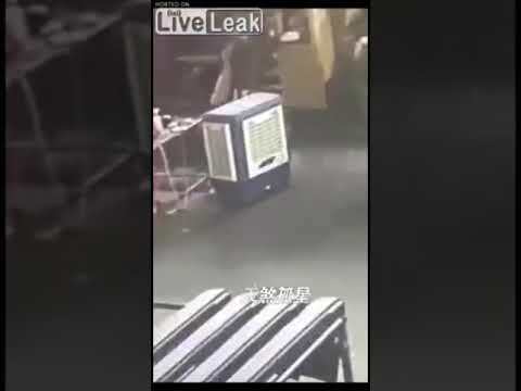 Female factory worker gets pressed by a machine
