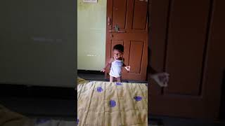 One year old boy doing funny with the ball