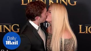 Meghan Trainor and Daryl Sabara kiss on 'Lion King' red carpet