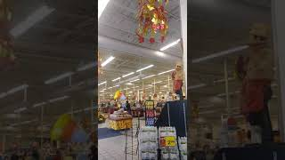 ET dressed in human suits at supermarket