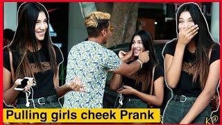 PULLING STRANGERS CHEEKS PRANK | PULLING GIRL