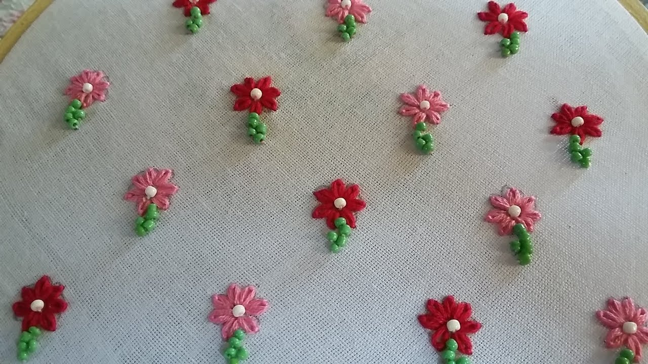 Hand embroidery of small flower design for allover