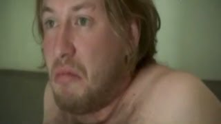 Morning after: fat hairy man in bed