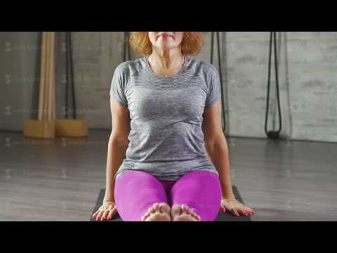 A mature woman performs asanas of yoga looking in camera from YouTube · Duration:  26 seconds